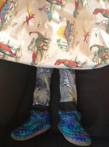 Dino pajamas under a dino duvet